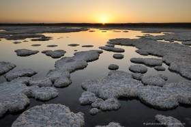 Sunset at Salar de Llamara. The white structures are gypsum crystals