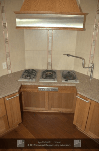 A pot-filler faucet is located near the cooktop and in-counter steamer