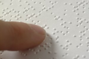 Finger on Braille print