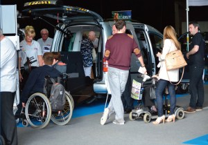 people standing around an adapted accessible car