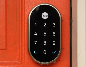 Nest x Yale Lock on a red door