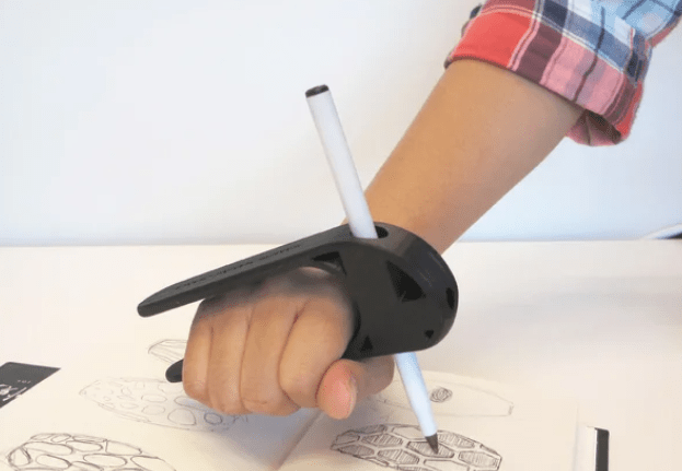 3D printed palm pen holder is a writing splint that slips onto the palm
