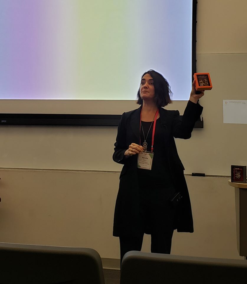 Professor Pernille Bjørn, AtariWomen presentation showing 3D printed AtariWomen Cartridge, Indiana University, December 2019, Picture by Jeffrey Bardzell