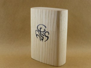 side view of a large cigarette box worked in chestnut wood