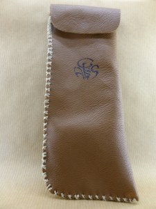 presentation of a handmade brown lamb leather bag