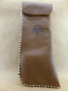 presentation of a handmade brown lamb leather bag