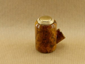 left view of my small e-pipe worked in bush of olive wood