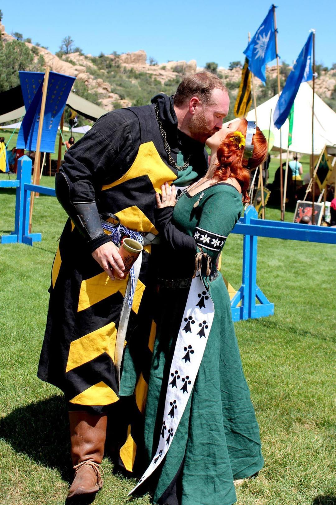 Brian and Lia kissing at a crown tournament