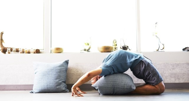 Man Stretching In Home Athelio
