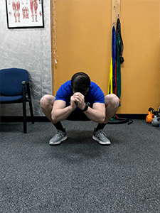 Squat with External Rotation Stretch