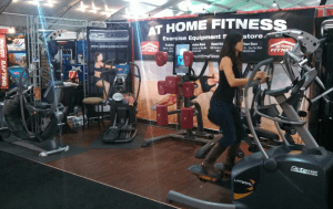 A customer tries out an Octane elliptical machine at the At Home Fitness booth during the Barrett-Jackson Auto Auction that will be going on until Sunday