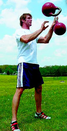 Athletic trainer and strongman Andrew Durniat juggles 70-pound kettlebells during a workout.