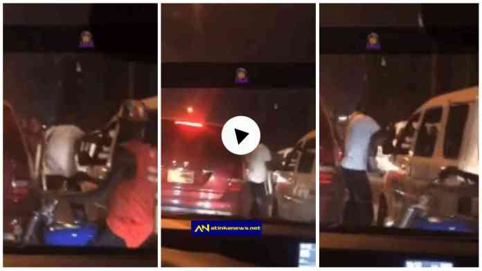 two men park their cars to engage in fierce fight