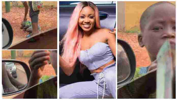 Akuapem Poloo shows real love to little boy sleeping on the street; video drops