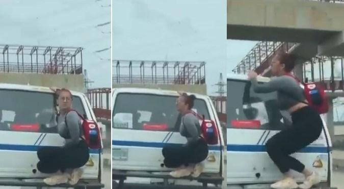 White woman spotted hanging on the back of a moving bus in Lagos