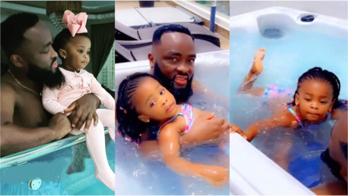 Mcbrown's daughter Baby Maxin shows off her swimming skills in a pool with father [Video]
