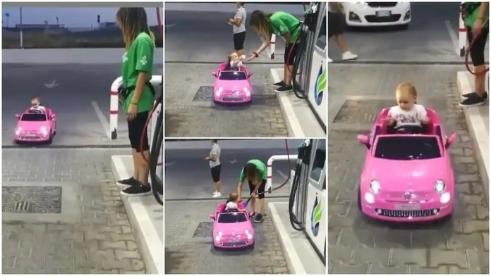 baby drives toy car to fuel station