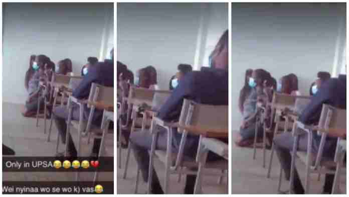 Ghanaian university students kneeling inside lecture hall