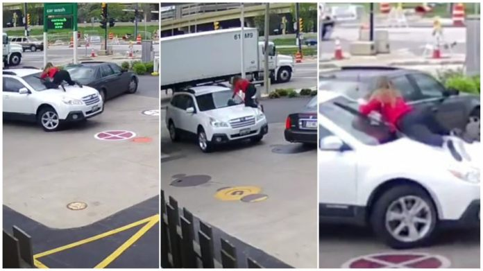 woman fearlessly jumps on top of her car