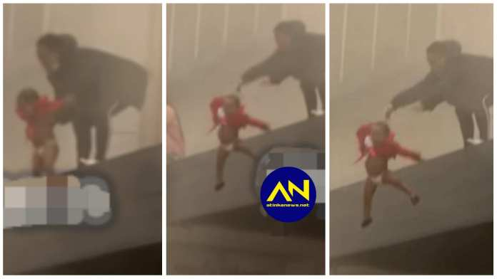 Mother throws child off building set on fire by looters