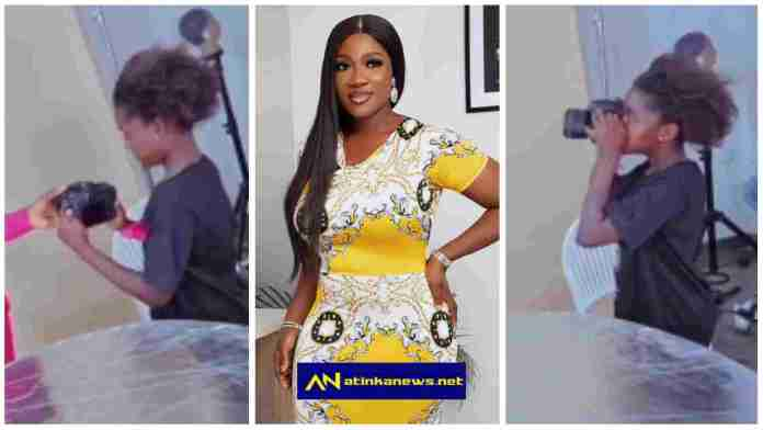 Mercy Johnson 's daughter, Purity, shows off her photography skills during mum's photoshoot
