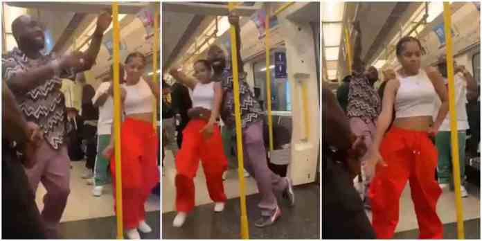 Davido dancing with an unknown lady in a moving train