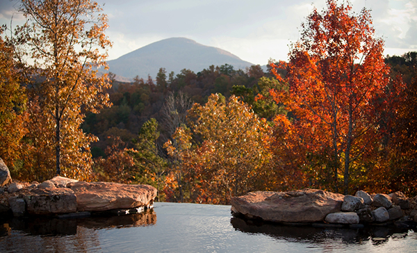 Fall scene of lake in the forest with mountain in background