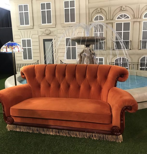 orange couch from the FRIENDS Experience