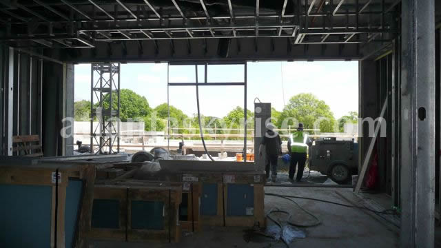 Below, inside the club area looking out to the pool deck.