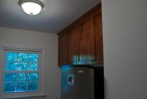 The clients also had cabinets installed in the adjacent laundry room that match the kitchen.
