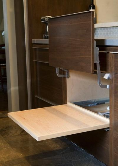 This cabinet and pullout were designed to house the family's microwave.