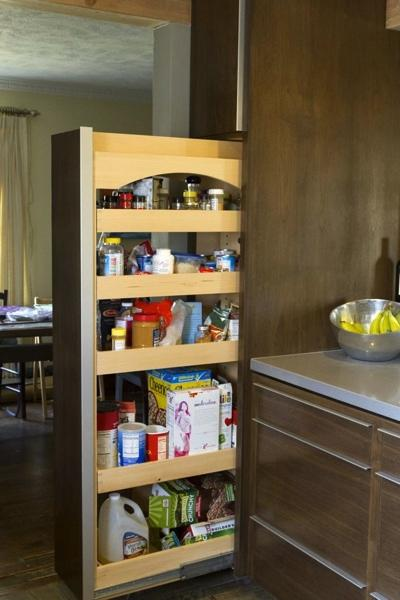 Custom pullout pantry with adjustable shelving.