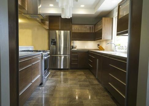 The kitchen features continuous grain running horizontally throughout the kitchen.