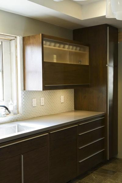 The upper cabinets feature lift doors as well as sliding glass doors that flip up out of the way.