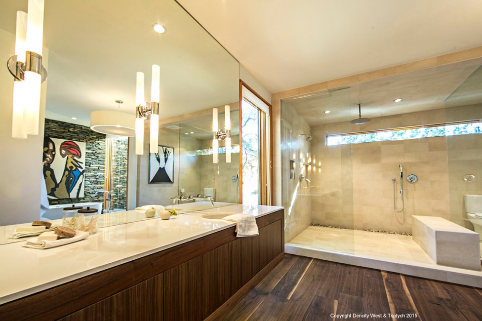 Floating master bath vanity with touch latch hardware on the drawers and doors.