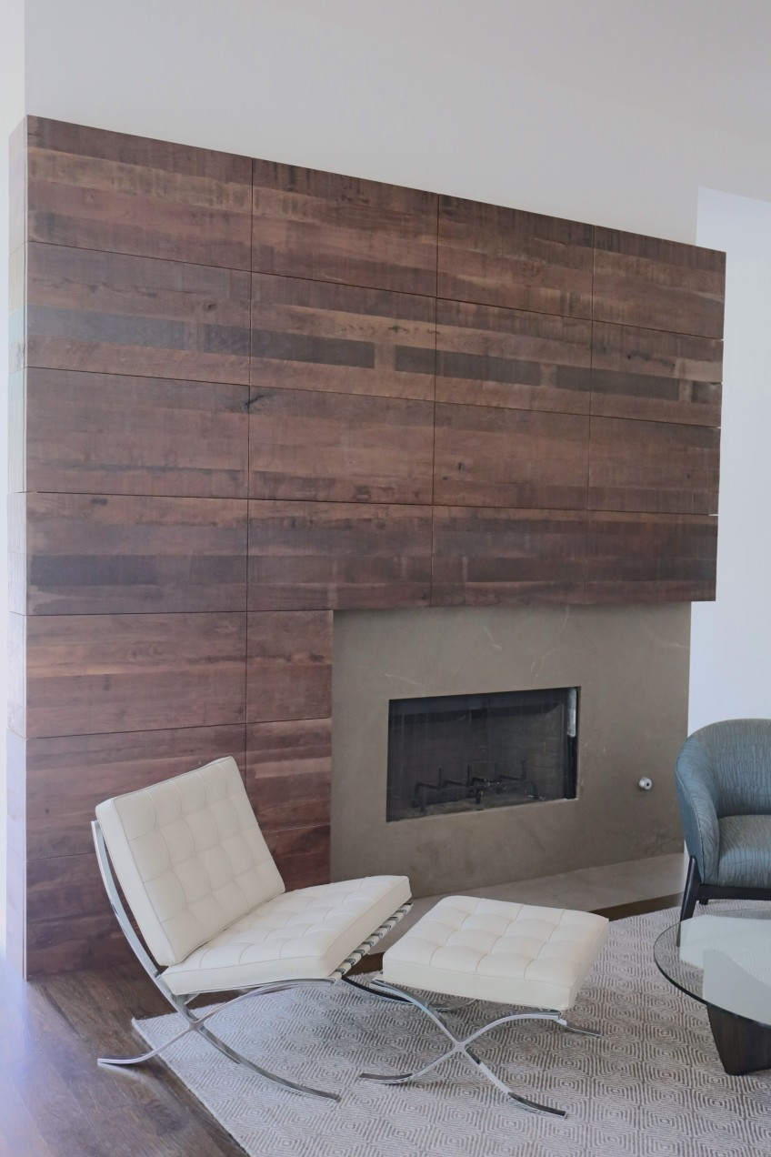 Fireplace wall – This is fashioned from walnut that we wire-brushed to maintain all of the original mill marks and defects. Panels in the middle open to expose the TV.
