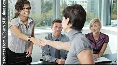 Image of a woman shaking hands on an office