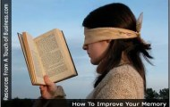 Image of a girl blindfolded while reading a book