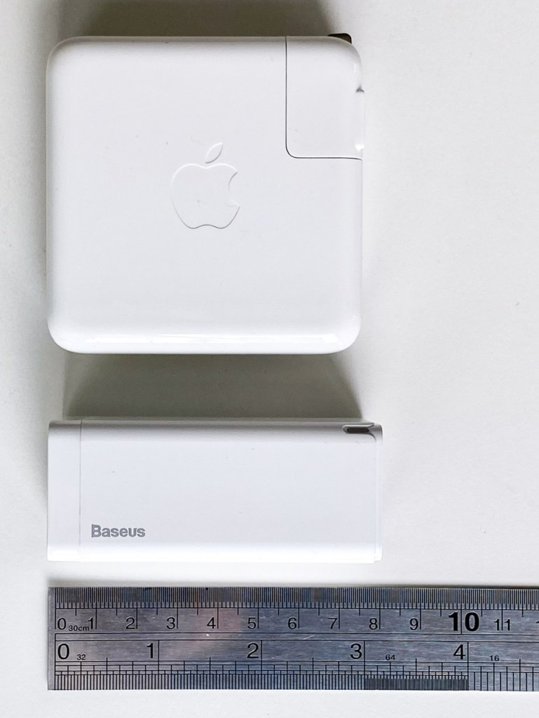 Baseus GaN 65W USB-C Charger compared with Apple MacBook Pro 61W USB-C Power Adapter - Side profile