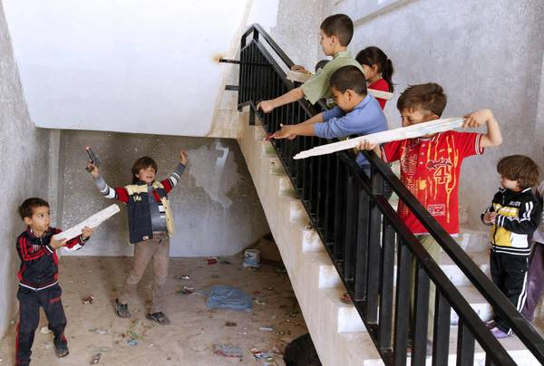 epa03194747 Syrian refugee children who fled the unrest in Syria with their families, play games in the hall of their building, at Ramtha city near the Syrian border, Jordan, 24 April 2012. According to a media reports about 10,000 Syrian refugees fled to Jordan since the beginning of the unrest in Syria. EPA/JAMAL NASRALLAH