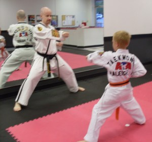 Glen Haase, Master Taekwondo Instructor, helps a student learn to control his actions.