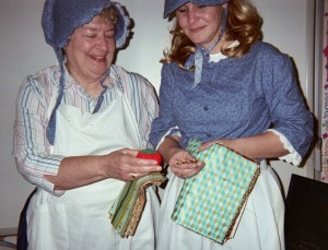 A teacher and her mother dress in prairie costumes to help students learn about pioneer days in the US.