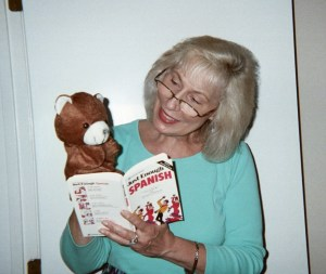 Hand puppets, like Little Bear, can help children learn more than languages.
