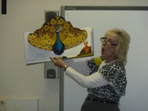 Open up a pop-up book and tell the class that the character you're showing is proud of the poems it writes! A peacock that writes poems? That's silly!
