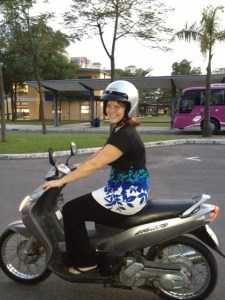 Karen Walsh rides a motor bike to her teaching job at UNIS, Hanoi, Vietnam.