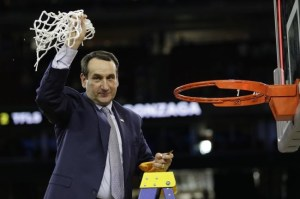 Coach K clips a net souvenir after a big win in the NCAA men's championship. Photo courtesy of bleacherreport.com