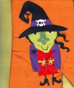 Biggest Witch has a face of green. She loves being biggest in the Halloween scene.