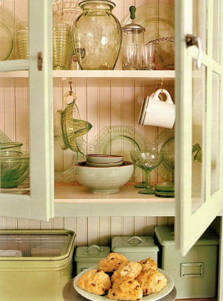 detail of glass-front cabinets in green retro cottage kitchen