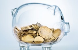 retirement savings piggy bank with gold coins