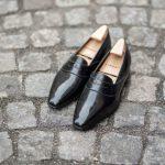Le mocassin penny loafer Darcy en cuir noir